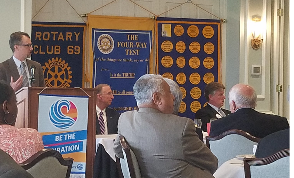 A professor speaks to a rotary club